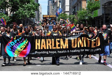 New York City - June 29 2014: Harlem United's large group marching at the 2014 Gay Pride Parade on Fifth Avenue