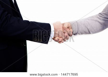 Handshake of business partners, when signing documents. Isolated on white background.