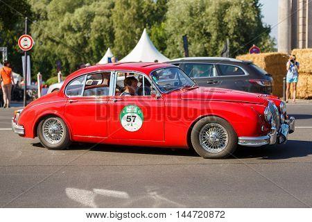 Potsdam Germany - August 27 2016: Retro car goes on a Glienicke Bridge in open motor Rally Hamburg-Berlin Klassik the date of August 25-27