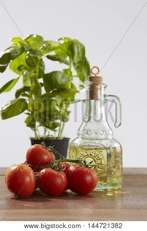 fresh tomatoes basil and bottle of olive oil
