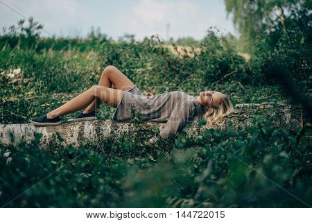 photo of beautiful girl in the felled forest