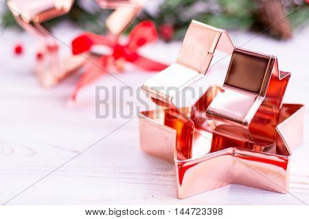 Star-form copper baking pastry form for Christmas cookies with Christmas decoration