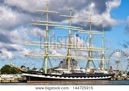 ROSTOCK, GERMANY - AUGUST 2016: Kruzenshtern or Krusenstern is a four-masted barque. Hansesail in Warnemuende and Rostock harbor.