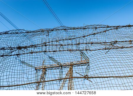 Barbed wire and lattice on the prison fence.