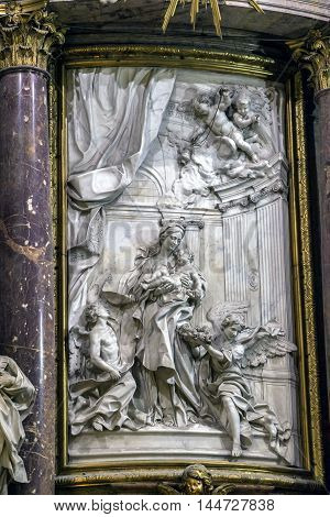 CUENCA SPAIN - August 24 2016: Interior of the cathedral of Cuenca detail of Major Chapel or High altar Closed by three grills Constructed in marble of carrara and jasper the marble was worn out for Blas de Renteria the sculptures and reliefs of the altar