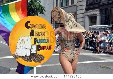 New York City - June 26 2010: Model for the Colombia Amor Fuerza Empuje group strikes a pose at the 2010 Gay Pride Parade on Fifth Avenue