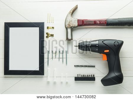 DIY home decoration set with screw driver hammer for picture frame DIY installation. Photo frame installation complete DIY set.