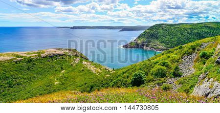 Wonderful summer day over the coastline and cliffs of a Canadian National Historic Site, Fort Amherst in St John's Newfoundland, Canada.
