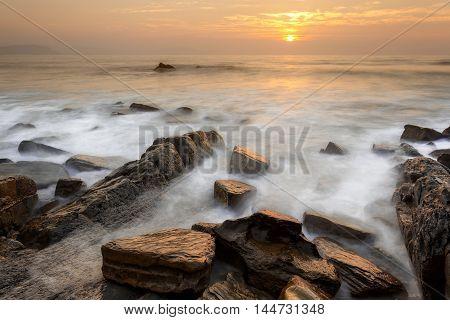 Summer sunset at Barrika beach in Spain