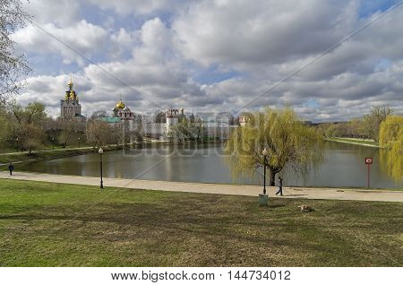 Moscow, Russia - April 21< 2016 : Pond at the walls of the Novodevichy Convent. Mid-April. Moscow Russia.