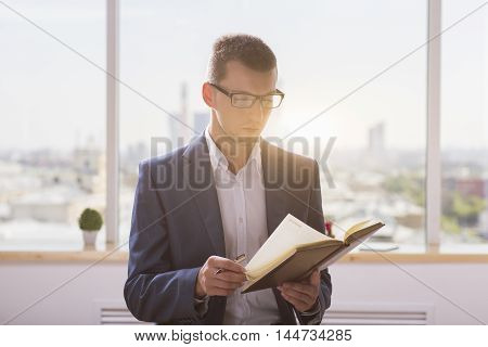 Businessman Flipping Notepad Pages