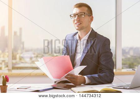 Smiling Businessman Doing Paperwork