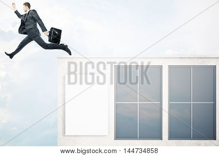 Businessman with briefcase jumping off roof of concrete building with windows and blank poster on sky background. Success concept. Mock up 3D Rendering