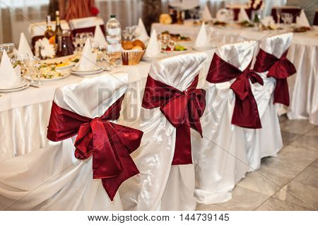 served a festive table for a wedding dinner in the restaurant.