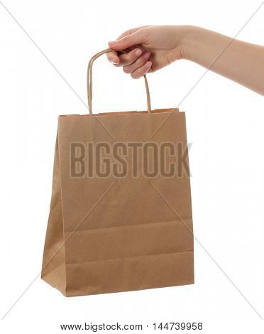 hand with paper bag