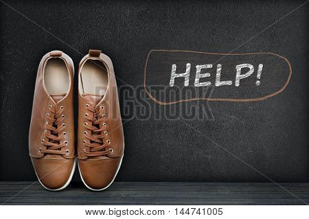Help text on black board and shoes