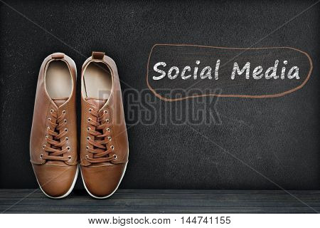 Social Media text on black board and shoes