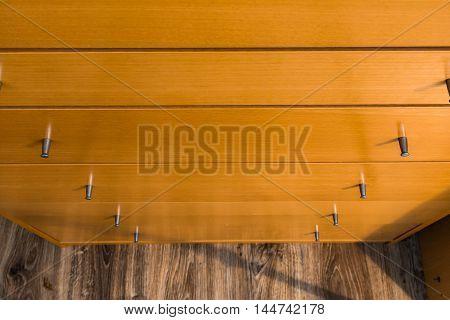 Knobs of Wooden Dresser Drawer Texture Pattern Background