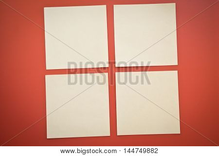 four clean note on a red background