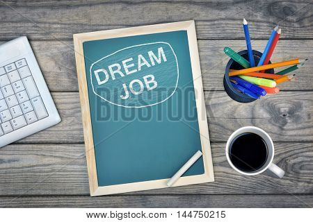 Dream Job text on school board and coffee on desk