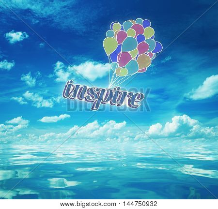Colorful air balloons with text above bright blue sea with reflected sky. Inspiration concept