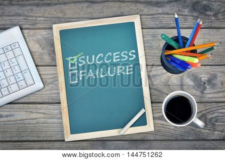 Success text on school board and coffee on desk