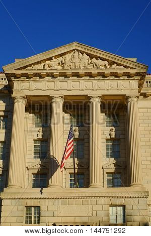 Washington DC, Department of Commerce Building with waving US flag