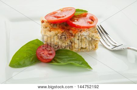 Southwest baked strada with sausage, cheese and tomatoes.