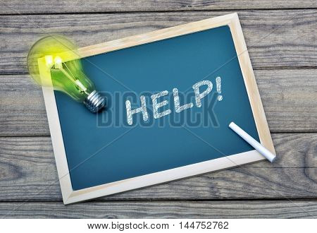 Help text on school board and glowing light bulb
