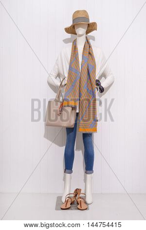 Full length female clothing with hat,scarf ,bag ,shoe on mannequin