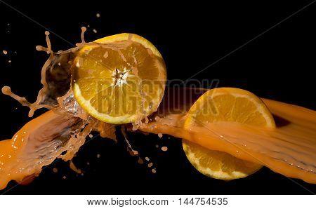 Oranges and orange juice splash on a black background.