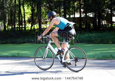 cyclist on bike rides on the highway