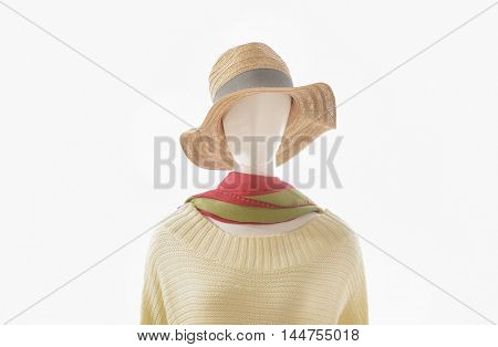 women dress with hat, scarf on dummy â??white background
