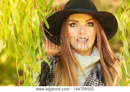 Fashionable Girl Hiding In Leaves