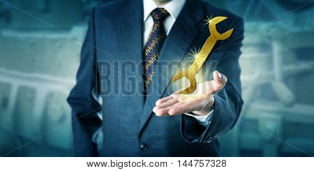 Unrecognizable male white collar professional is presenting a sparkling golden virtual wrench in the palm of his left hand. Business concept for solution support success capability and innovation.