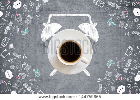 Coffee cup alarm clock sketch on grey wooden desktop with communication drawings