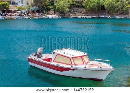 Small Motorboats Moored In Clean Water