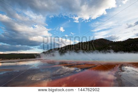 The Grand Prismatic Hot Spring at sunset in the Midway Geyser Basin along the Firehole River in Yellowstone National Park in Wyoming US of A