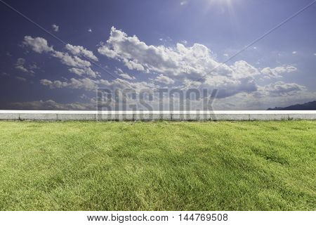 landscape of hill and sky from empty green meadow