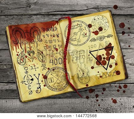 Old alchemy book with bloody hand print and drops lying on wooden table. Halloween still life, black ritual with occult and esoteric symbols