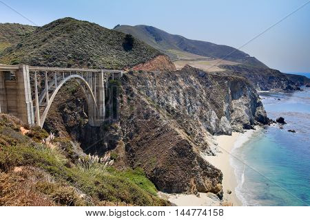 Bixby Bridge, Big Sur, California, USA. Bixby Creek Bridge, also known as Bixby Bridge, is a reinforced concrete open-spandrel arch bridge in Big Sur, California. The bridge is located 120 miles south of San Francisco and 13 miles south of Carmel in Monte
