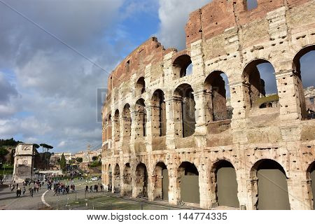 ROME, ITALY - JANUARY 10: Coliseum and roman archeological area with tourists and beautiful cloudy sky JANUARY 10, 2016 in Rome, Italy