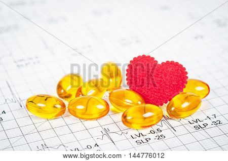Vitamins Heart and with red heart on cardiogram report paper background.