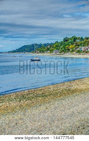 A boat is moored in front of residences in Wast Seattle Washington. HDR image.
