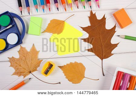 School Accessories, Shape Of Building And Autumnal Leaves On White Boards