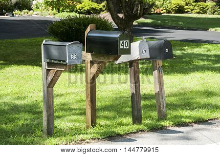 American outdoor metal mailboxes on wooden supports