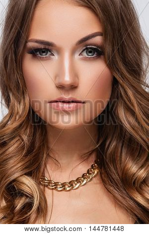 Young lady with luxury accessories on white background