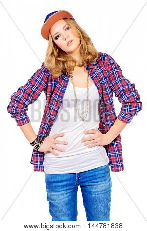 Modern teenager girl wearing casual clothes and a cap posing at studio. Teen generation. Youth fashion style. Isolated over white.