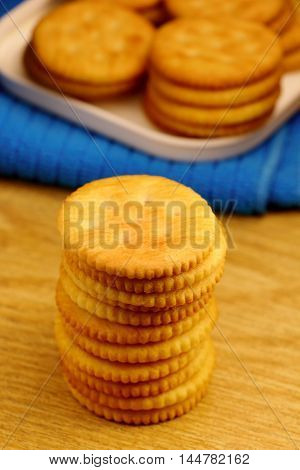 stack of biscuit cookies on wood background.