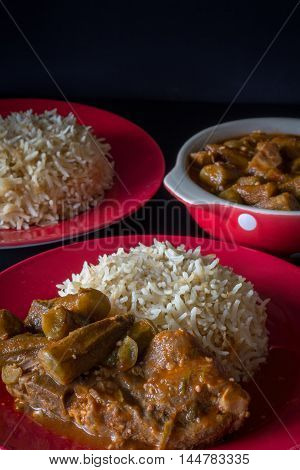 Middle Eastern Bamiya with Rice on Dark Background Vertical